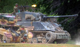 M4A2 Sherman and M3A1 Stuart give covering fire