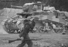 A British Tommy advance past a Stuart tank