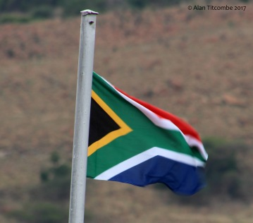 Reconciliation with the modern South African flag flying over Rorke's Drift